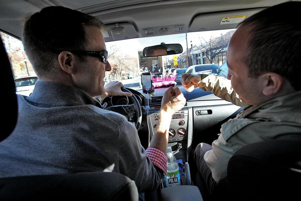 Gig economy workers have few if any traditional workers' benefits.  Above, driver Gabriel Gill- Austern (left) greeted Lyft customer Dan Luria with a fist bump.